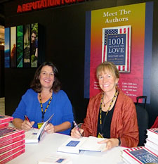 Holly and Kathie sign their second book, 1001 Things to Love About Military Life, at the AUSA 2012 conference.