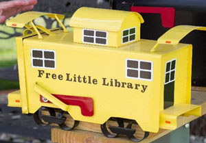 Sharing Books in a Little Free Library - Books Make a Difference