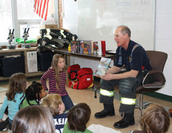 Tim Hoppey, author of The Good Fire Helmet, reads to children in schools.