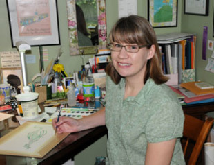 Nina Victor Crittenden paints children's books at her home studio