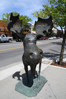 Mudgy and Millie statues in downtown Coeur d'Alene, Idaho, give residents and visitors alike a sense of adventure as they follow the Mudgy Moose Trail.