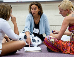 Mimi Herman consults with writers Heather and Megan at a writers' workshop. Photo by Gary O'Brien.