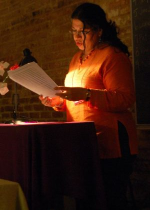 A participant in the Iowa Summer Writing Festival reads her manuscript aloud.