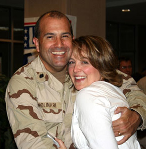 Lisa and her husband, Francis, at one of his deployment homecomings.