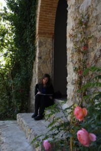 Karen writes longhand in a beautiful spot on the side of an old chapel on the villa grounds.