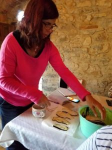 Writeaways participant Sharyn, working with eggplant.