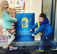 Eileen and Jerry Spinelli's grandkids excited to see grandfather's book cover in bookstore window