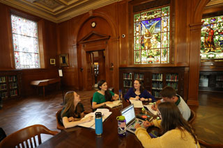 Baylor students gather to study in the Leddy Jones Research Hall at Armstrong Browning Library. In the background on the right is the window depicting a scene from The Pied Piper of Hamelin. (Courtesy Baylor University)