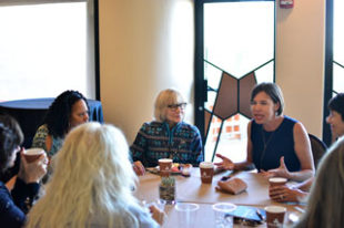 Author and publisher Brooke Warner connects in a small group setting at a retreat especially for women writers.