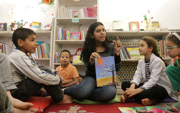 Librarian Samia Bachraoui reads aloud to children in the Medina Children's Library in Fez, Morocco
