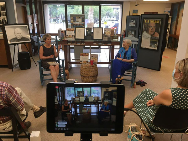 "Chef Nathalie Dupree, seated right, tells stories and discusses her book, ""Nathalie Dupree's Favorite Stories and Recipes,"" with in-person and virtual audiences at an event at the Pat Conroy Literary Center. Photo courtesy of the Pat Conroy Literary Center."