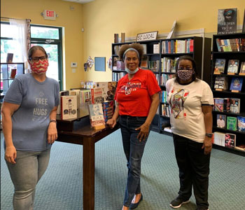 VaLinda Miller (center) owner of Turning Page Bookshop in South Carolina, in her store with local librarian friends Theresa Wagner and Maya Hollinshead. Photo courtesy of Turning Page Bookshop.