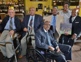 """Civil rights activist David Boone, left, who took part in 1960s sit-ins, and Friendship Nine members Clarence Graham, James Wells, Willie McCleod, and W.T. """"Dub"""" Massey, meet with author Kimberly Johnson, second from right, at the former McCrory's store, now the Five and Dine restaurant, in downtown Rock Hill."""