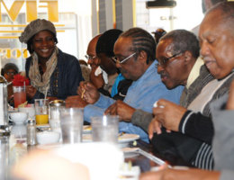 """Kimberly celebrates with the Friendship Nine at the Five & Dine lunch counter on the 54th anniversary of their protest that initiated """"Jail, No Bail."""" Photo by Karen Pavlicin-Fragnito."""