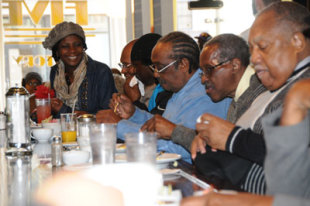 "Kimberly celebrates with the Friendship Nine at the Five & Dine lunch counter on the 54th anniversary of their protest that initiated ""Jail, No Bail."" Photo by Karen Pavlicin-Fragnito."