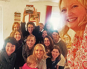 Stacy Huisman hosts a group of military spouses at her home in Germany, using Stories Around the Table as a conversation starter.