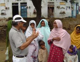 Suri Sehgal listens to village women in India.