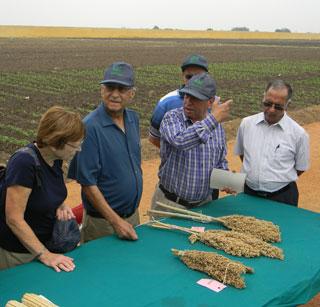 Suri and Edda Sehgal meet with hybrid corn breeders