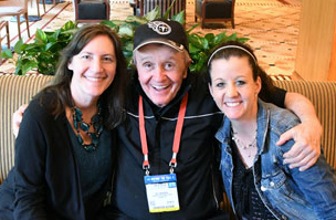 Aspiring songwriters Karen Pavlicin-Fragnito and Meagan Frank enjoy a hug from songwriting great Bill Anderson as he shares his revelation that you are never too late or too old to follow your dreams.
