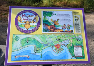 Alongside each life-size bronze Mudgy and Millie statute, a placard displays an illustration of the Mudgy Moose Trail and the page from the children's picture book that corresponds to the visitor's current location in Coeur d'Alene. The 2-1/4-mile trail leads visitors to five locations in the downtown and lake resort area to experience the town's key points of interest.