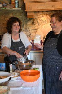Italian chefs Gabry and Giusy prepping castagnaccio.