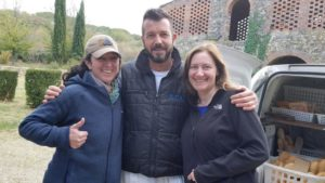 JT and Karen greet Fabio, who delivers bread to the villa each morning.