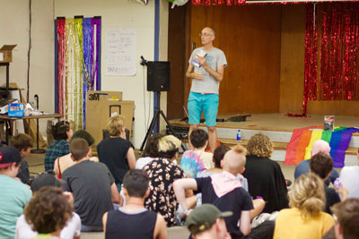"Over 900 copies of ""Queer as a Five-Dollar Bill"" by Lee Wind were donated to LGBTQ and Allied Teens through a crowdfunding campaign. Here, Lee speaks to youth who received copies of his book at Camp Brave Trails in California."