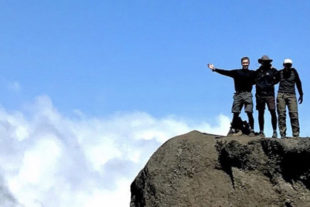 Joel Neeb, coauthor of Survivor's Obligation, climbing Mount Kilimanjaro in Tanzania, with a group of fellow survivors.