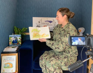 At Story Station events, United Through Reading provides recording equipment and a selection of picture books for military members to read and create video recordings for important children in their lives.