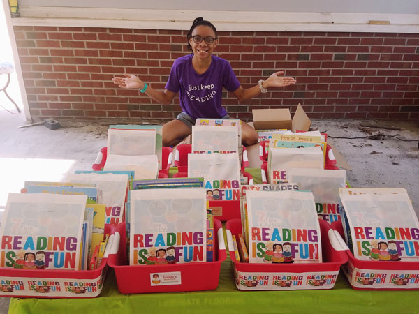 Sydney Dickerson of Sydney's Book Club gets ready to share boxes of books with day care centers and preschools in Wayne County, North Carolina.