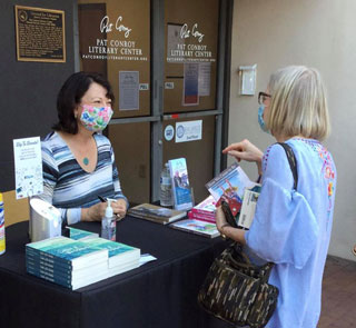 Authors Johnnie Bernhard and Cassandra King meet and chat at a book-signing event at the Pat Conroy Literary Center. Photo courtesy of the Pat Conroy Literary Center.