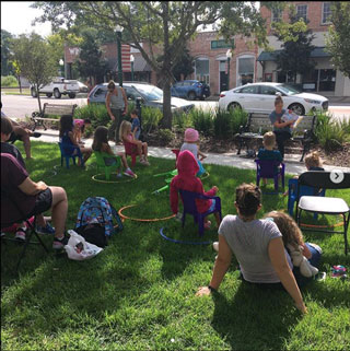 Main Street Reads holds weekly story time for kids—with hula hoops to help with social distancing—on the town square across the street from their store in South Carolina. Photo courtesy of Main Street Reads.