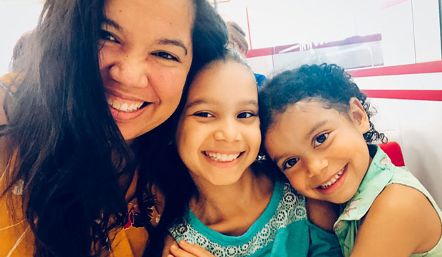 Fantasy author J. Elle with her daughters.